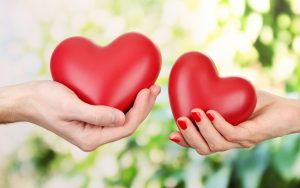 couple_hand_holding_heart-wide